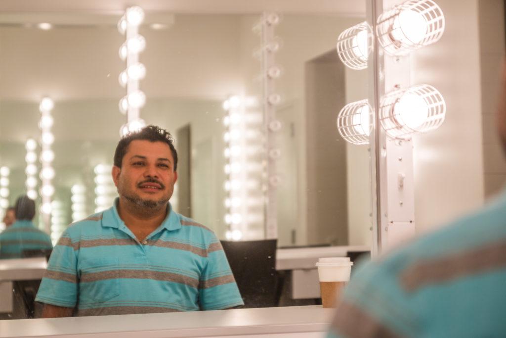 Proyecto Carrito Caravan co-director Mario Ernesto Osorio prepares in the Emerson Los Angeles dressing room.