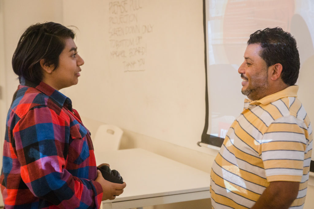 A Woodbury University student talks with Mario after the presentation.